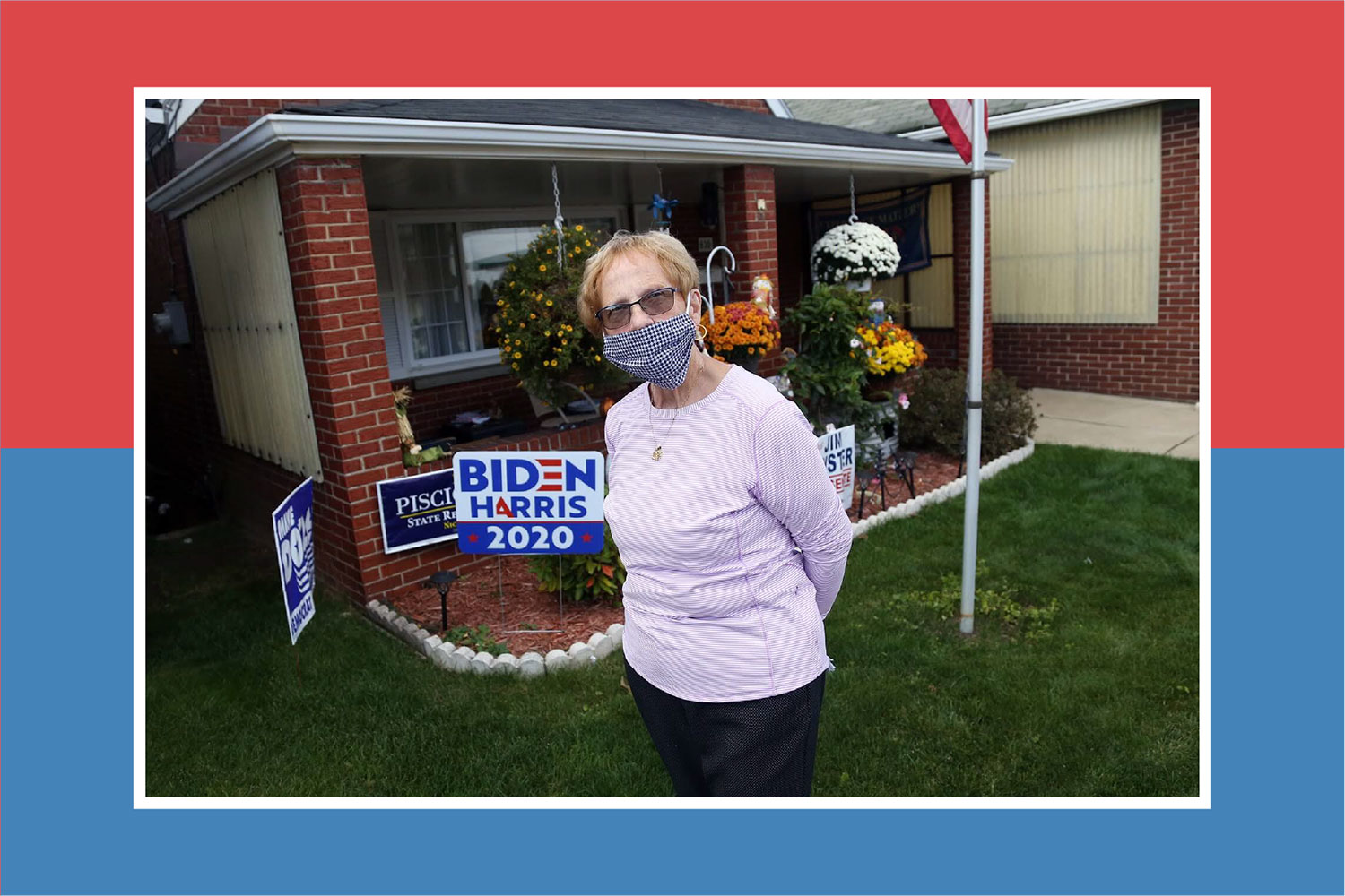 Rosemary Bradley in a black and white checkered mask, standing in her yard in front of a BIDEN HARRIS 2020 yard sign.